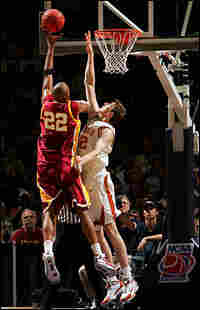 Taj Gibson of USC shoots over Connor Atchley of the Texas Longhorns.