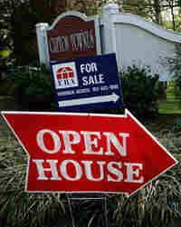 Sale and open house signs are posted in a neighborhood of Centreville, Va.