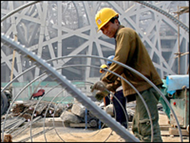 A Chinese construction worker works on steel bars at a construction site of the National Stadium in Beijing. China is the world's biggest producer and consumer for steel. It became a net steel exporter in December 2006, for the first time in more than 20 years.