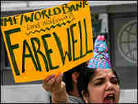 A protester demands World Bank President Wolfowitz resign.