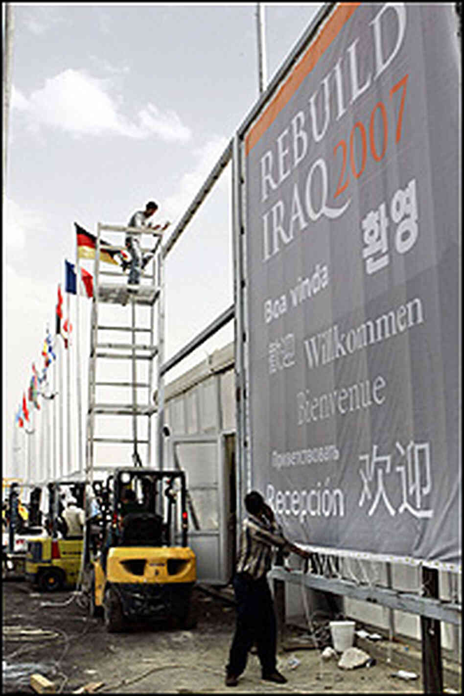 Workers prepare for the 'Rebuild Iraq 2007' conference in Amman, Jordan, held earlier in May.