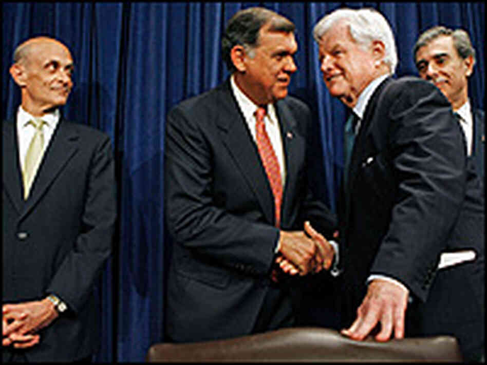 Sen. Mel Martinez and Sen. Ted Kennedy shake hands at a news conference on the immigration deal.