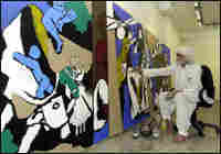 M.F. Husain creates a painting in 2003.