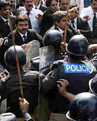 Pakistani riot police scuffle with lawyers protesting the declaration of emergency rule.