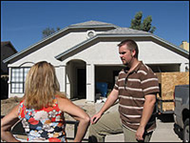 "Home ""stager"" Donna Butera and homeowner-investor Keevin Simpson at his home for sale in North Phoenix."