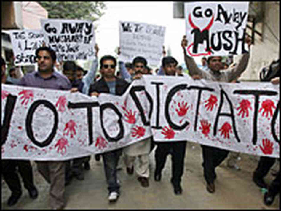 Pakistani students march against the imposition of emergency rule in a protest in Islamabad.