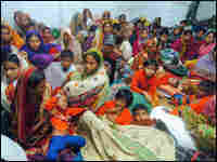 Bangladeshis take shelter at the Chila cyclone shelter near the capital, Dhaka.