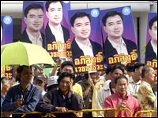 Supporters of Thailand's Democrat Party hold pictures of its president, Abhisit Vejjajiva, in Bangkok earlier this month.