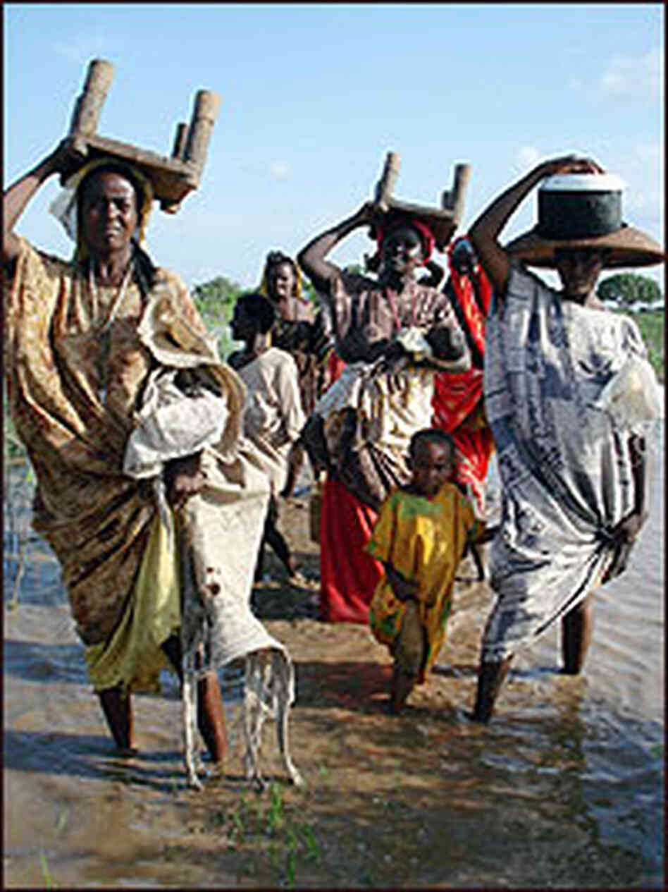Somali women carry some of their belongings on their heads