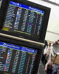 Monitors show departing flights at Newark Liberty International Airport in Newark, N.J..