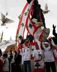 Lebanese youths release pigeons during a parade to mark the country's independence.