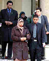 The families of two youths leave the Elysee presidential palace courtyard in Paris.