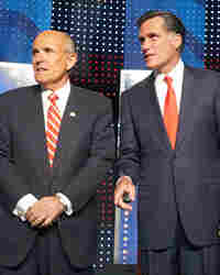 Rudy Giuliani and Mitt Romney wait for their Sept. 5 debate to begin in New Hampshire.