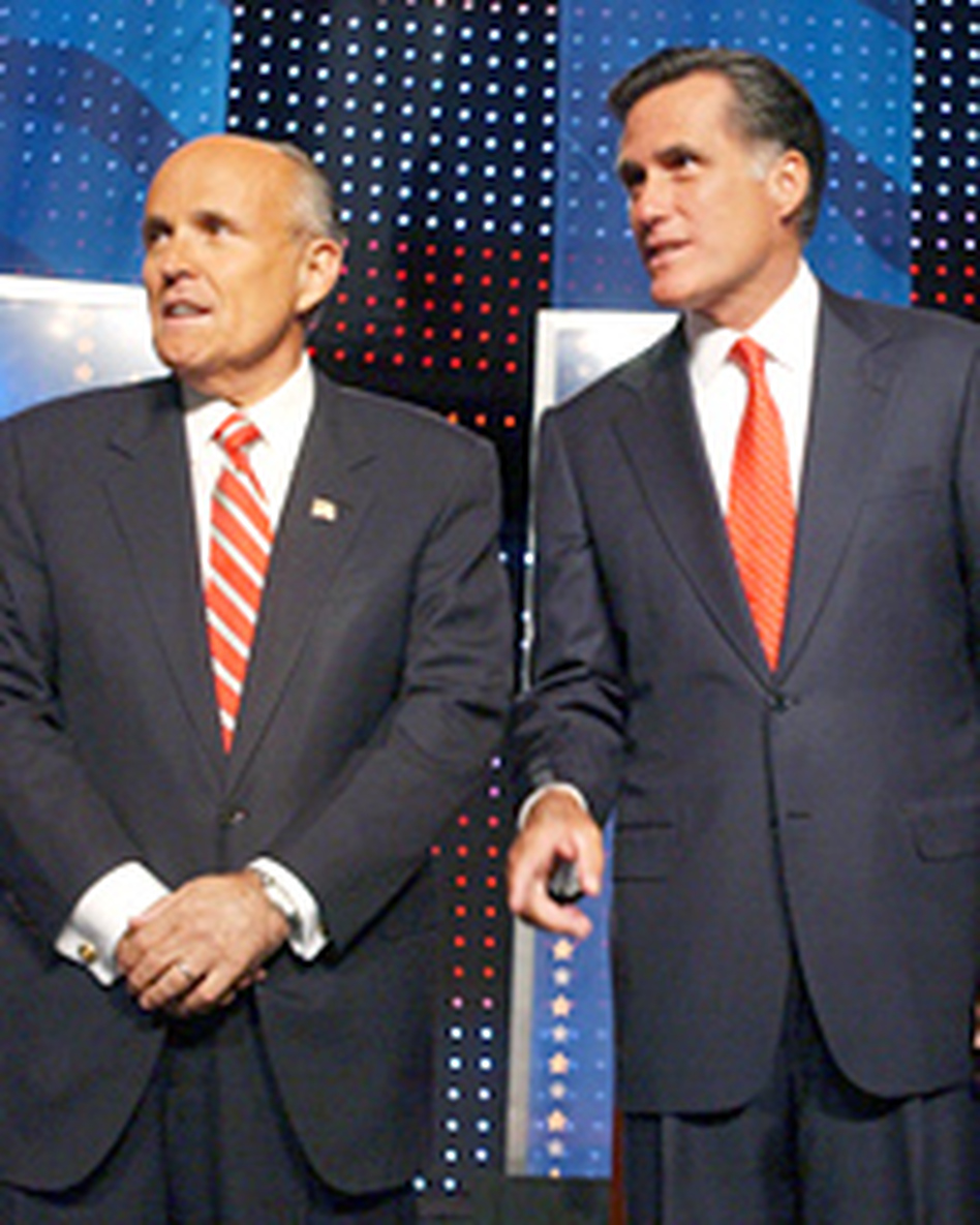 <strong>Looking to the Right</strong>: Rudy Giuliani and Mitt Romney wait for their Sept. 5 debate to begin at the University of New Hampshire in Durham.