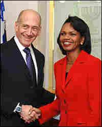 Israeli Prime Minister Ehud Olmert greets U.S. Secretary of State Condoleezza Rice in Jerusalem