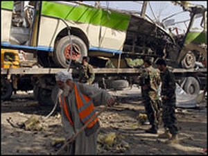 Municipal workers clean up after a suicide attack in Kabul, Afghanistan, earlier this month.