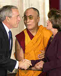 The Dalai Lama of Tibet stands with President Bush Speaker of the House Nancy Pelosi