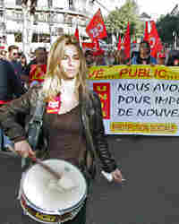 French public workers demonstrate in Marseille, during a 24-hour strike against the government's ref