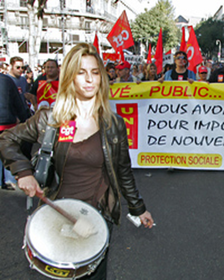 French public workers demonstrate in Marseilles, during a 24-hour strike against the government's reform plans of historic pensions privileges.