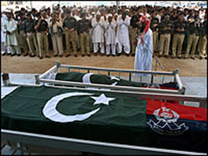 Mourners attend a funeral for two policemen killed in attacks in Karachi, Pakistan.