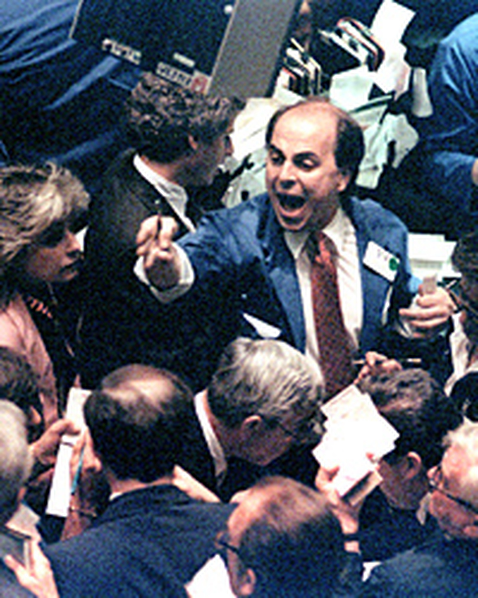 A trader on the New York Stock Exchange shouts orders on Oct. 19, 1987, as stocks were devastated during one of the most frantic days in the exchange's history.