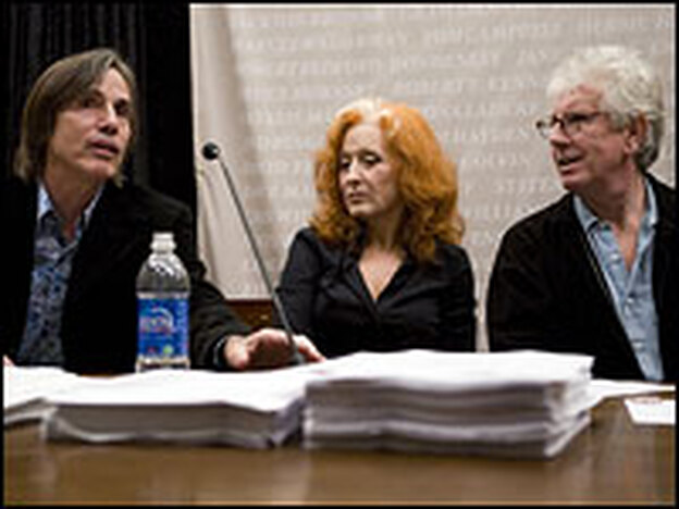 Bonnie Raitt (center) listens to Jackson Browne (left) speak during a news conference on Capitol Hill while Graham Nash looks on, Oct. 23, 2007. Raitt, Browne and Nash joined members of Congress and environmental groups to speak about an anti-nuclear campaign they support.