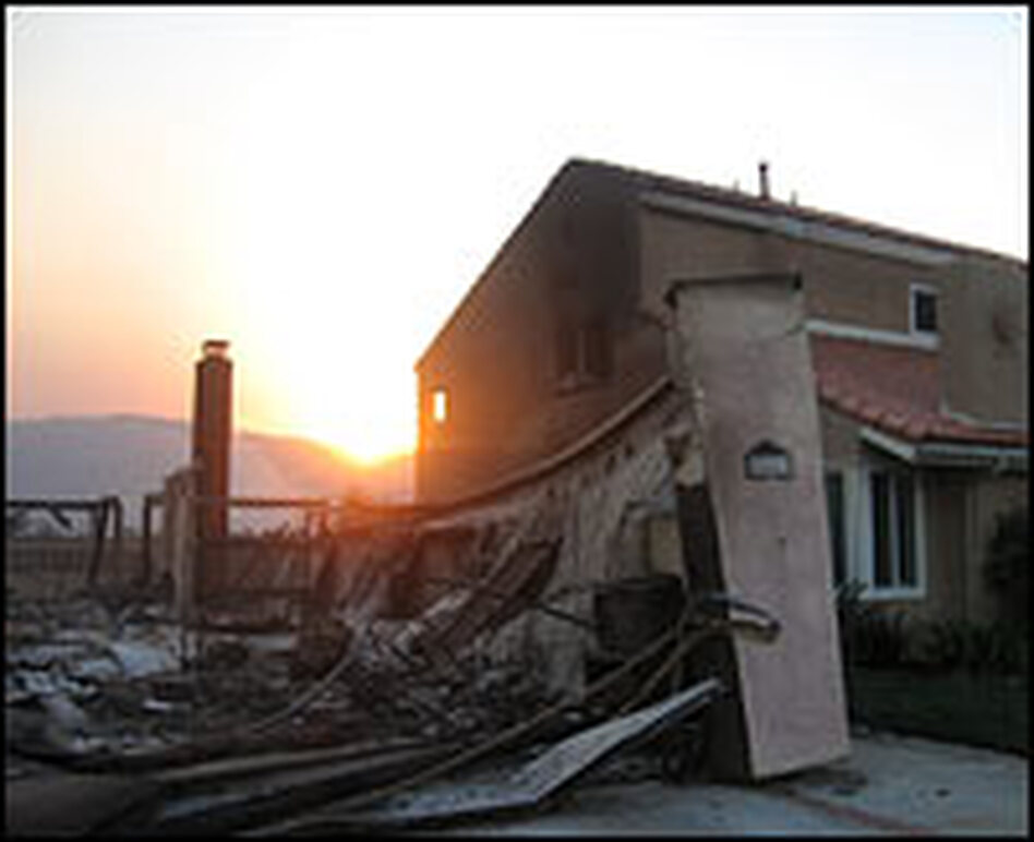 A wildfire claimed a house in the town of Poway in northern San Diego County while sparing the residence next door.