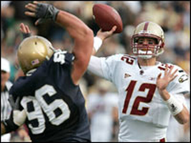 Boston College quarterback Matt Ryan passes under pressure from Pat Kuntz of Notre Dame, Oct. 13, 2007, in South Bend, Ind. Boston College won 27-14, and remains undefeated.