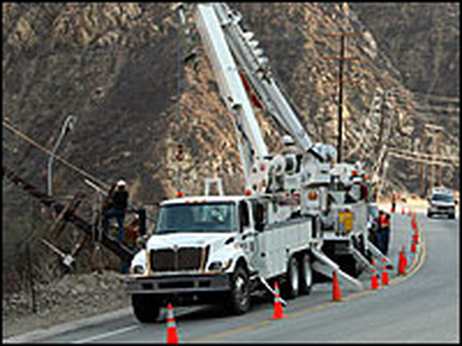Crews work to repair power lines on Tuesday damaged by wildfires in Malibu, Calif. Field personnel are working long hours to repair extensive damage caused by the fires.