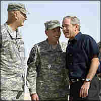 President Bush with Gen. David Petraeus, Adm. William Fallon.