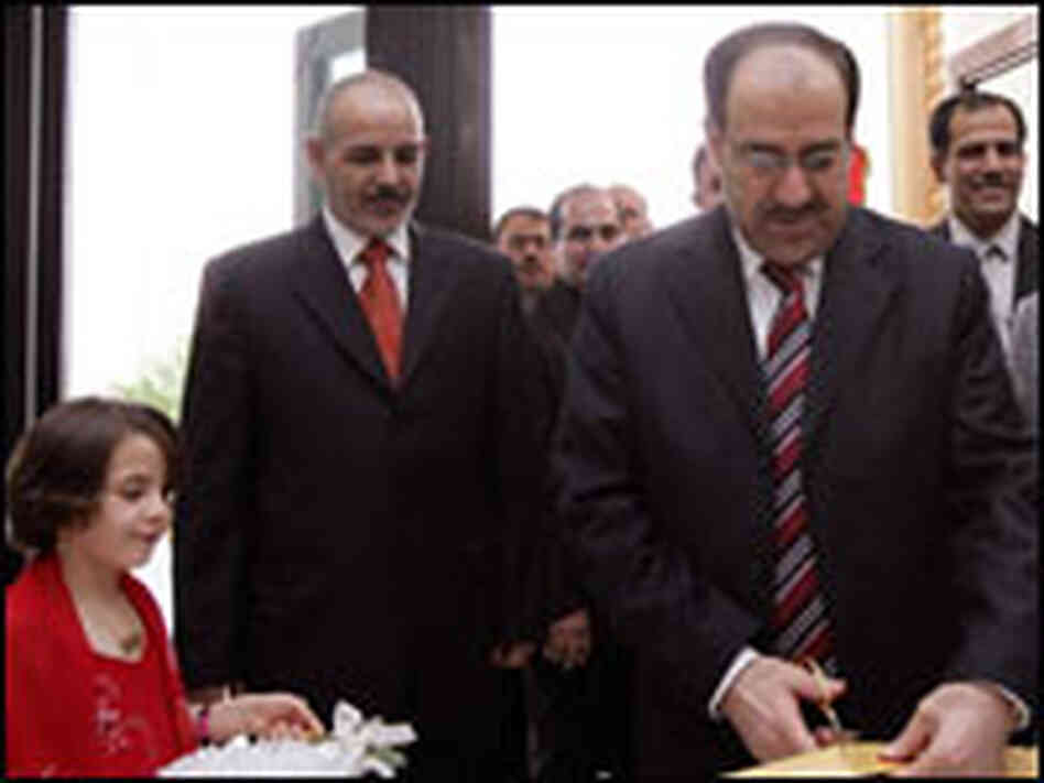 Iraqi Prime Minister Nouri al-Maliki cuts a ribbon during an opening ceremony in Baghdad.
