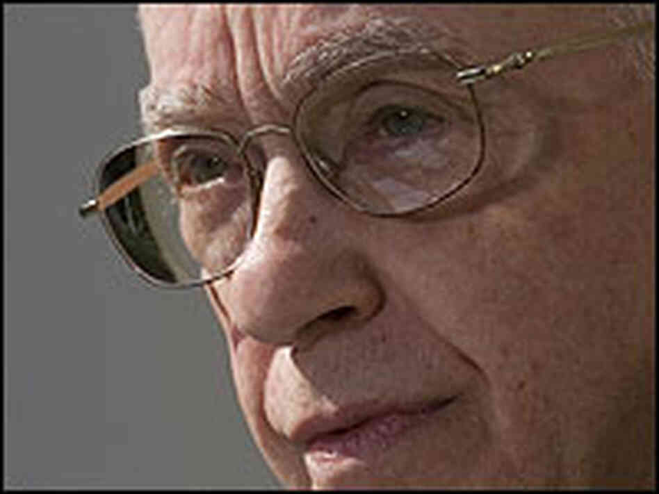 A tight shot of the face of retired judge Michael Mukasey
