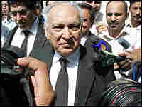 Pakistan government attorney Sharfuddin Pirzada leaves the country's Supreme Court building Tuesday.