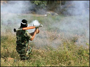 A Palestinian militants of the Popular Resistance Committee fires a rocket propelled grenade.