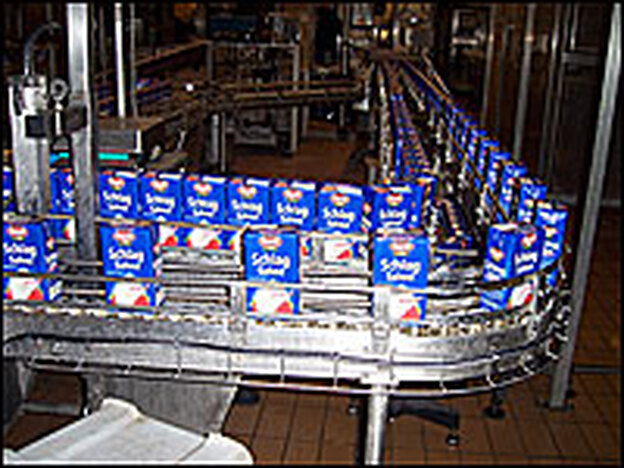 "Freshly-boxed whipping cream rolls off the conveyor at the Frischli factory in central Germany. Prices of all milk products are rising worldwide, due to what some call a ""perfect storm"" of low supply and high demand."
