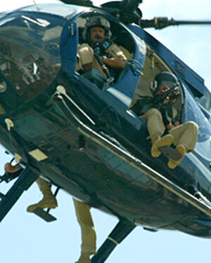 A file photo shows a Blackwater helicopter patrol over Baghdad in 2004. (Patrick Baz/AFP/Getty Image