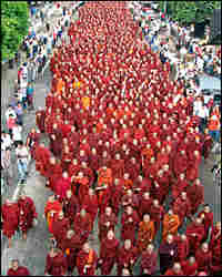 Buddhist monks march on a street in protest against the military government in Yangon, Myanmar.