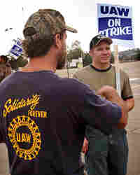 United Auto Workers members picket outside General Motors' assembly plant in Wisconsin.