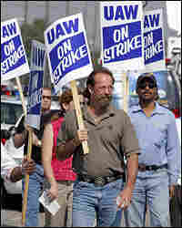 UAW members walk the picket line during a strike at the GM Powertrain Plant