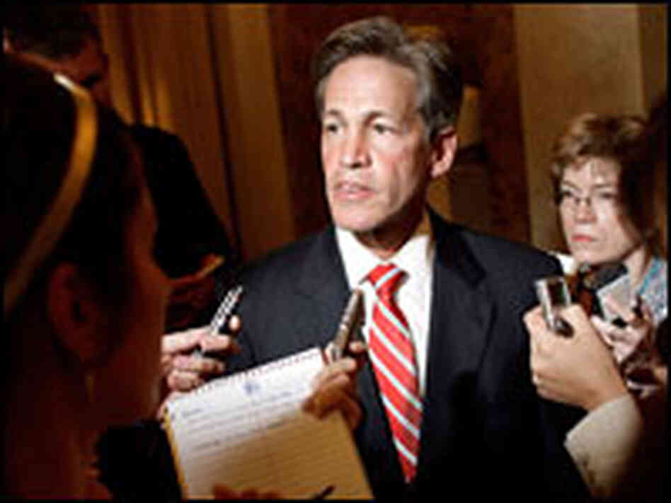 Sen. Norm Coleman talks with reporters in Washington, July 9, 2007.