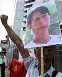 Protestors display pictures of detained Myanmar pro-democracy leader Aung San Suu Kyi