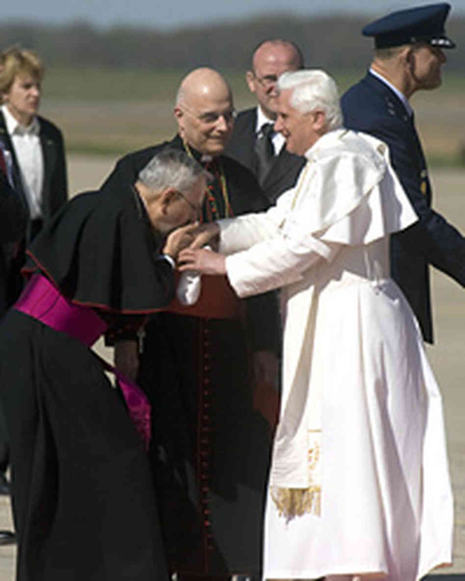 Bishop of Tucson Gerald F. Kicanas kisses the hand of Pope Benedict XVI.