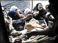 Customers compete to buy the next batch of fresh bread at a subsidized baker in Cairo, Egypt