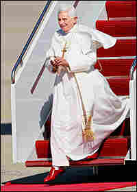 Pope Benedict, sporting red loafers, steps on U.S. soil at Andrews AFB.