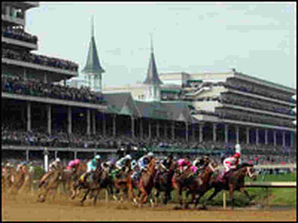 Horses round the first turn during the 133rd Kentucky Derby.
