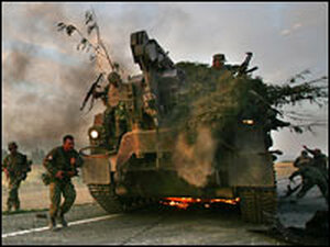 Georgian soldiers escape their burning armored vehicle on the road to Tbilisi on Aug. 11, 2008.