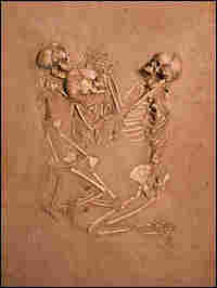 The skeletons of a woman and presumably her children posed in death.