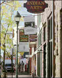 Arts stores and pedestrians in downtown Flagstaff.