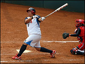 Crystl Bustos of the United States hits a three-run home run against Japan.