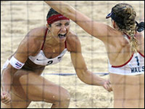 Americans Misty May-Treanor (left) and Kerri Walsh celebrate their Olympic gold medal victory over China's Tian Jia and Wang Jie in women's beach volleyball in Beijing.